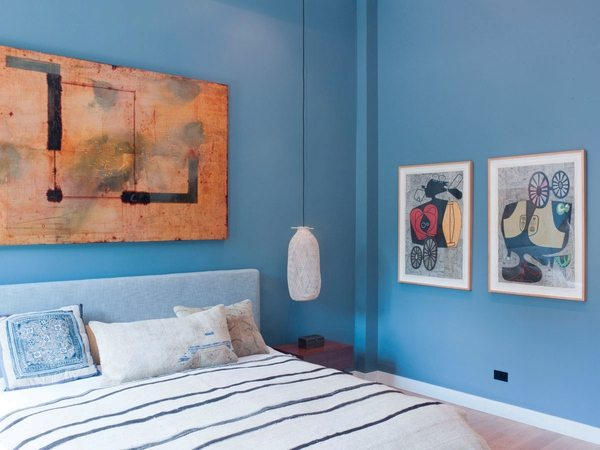 Michael Kessler painting in a New York City loft. As illustrated in Interior Design Magazine